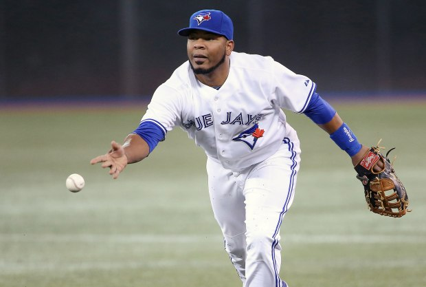 Toronto Blue Jays first baseman Edwin Encarnacion fields a groundball in a Major League Baseball game.